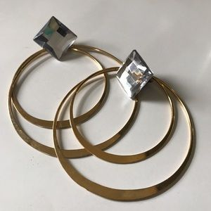 Gold hoop earrings with diamond detail